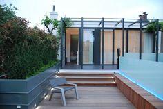 In samenwerking met Kees Marcelis een strakke moderne daktuin aangelegd