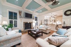 Living room with coffered ceiling & painted accents