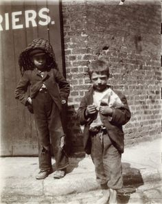 Two young 'street urchins' in Red crosS street ,London. 1901