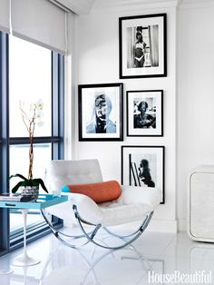 A teal side table adds color to a black and white room.