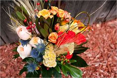 fall bridal bouquet with peach/ yellow/ orange/orange-red roses &/ berries/wheat