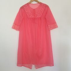 """Vintage Luscious Raspberry Nylon Robe True vintage nylon nightgown robe with floral lace bib and sleeve trim. Two ties at upper chest; the bottom flows open. Wear over a romantic nylon nightie and feel like the heroine of a '60s Hollywood melodrama. In excellent condition with no stains, holes, or tears.   Label: Henson Kickernick Marked size M - true to modern size M, but see flat measurements  FLAT MEASUREMENTS: 13"""" shoulders (edges of bib top detail) 20"""" bust 38.5"""" length  Reasonable…"""