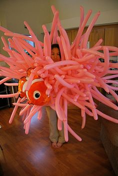 What a creative costume. Instead of using balloons you might be able to use cut pool noodles. Just a thought.