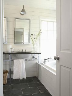 white bathroom with planked walls-love this floor!