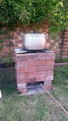 Wide Rocket Stove Picture of Cook on It!The Picture The Picture may refer to: Rocket Stove Design, Diy Rocket Stove, Rocket Stoves, Brick Grill, Outdoor Projects, Outdoor Decor, Outdoor Stove, Cooking Stove, Cooking Pork