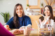 Cute women getting a manicure stock photo