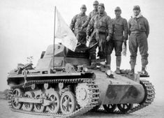 Japanese troops with a captured German-built Chinese Army Panzer I tank, possibly near Nanjing, China, 9 Dec 1937