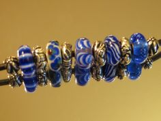 Trollbeads - A blue and white combo on my leather necklace ... with the Chinese Zodiac silvers.