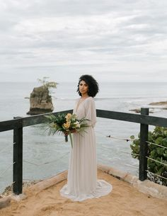 This bride wore a beautiful long sleeve gown with intricate sequin details | Image by Raw Shoots Photography Wedding Costs, Budget Wedding, Wedding Blog, Destination Wedding, Ceremony Backdrop, Wedding Ceremony, Wedding Budget Breakdown, Tropical Floral Arrangements, Elegant Ball Gowns