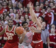 Wisconsin's Bronson Koenig, right, stops Ohio State's JaQuan Lyle (13) during the second half of Wednesday's game.