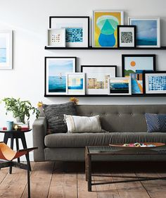 How to Create the EasiestGallery Wall Ever | Thisdisplay is easily adaptable, so you can add pieces or shift them around when you want. Here's the how-to, plus informationon the art shown.