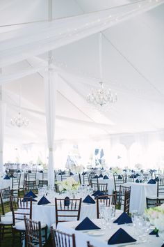 White tent with chandeliers | Photography: Julia Wade - julia-wade.com | Draping, Decor, Furnishings: Ryan Designs - ryan-designs.com | Read More: http://www.stylemepretty.com/destination-weddings/2014/06/04/navy-pink-block-island-wedding/