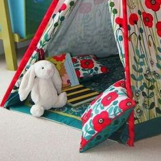 Soft space in tipi. Note  the poles are covered with fabric attachment