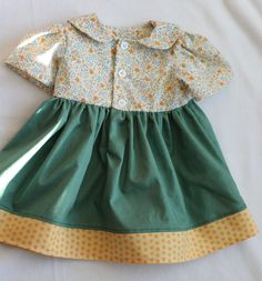 hand made baby dress, 100% cotton. Made by Suzanne Flumerfelt in Canada