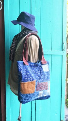 Patchwork Bag,Indigo Totes Bag, Line Stitched Bag This is handmade Boro tote bag, created from Thai textiles, patchwork,line hand stitched. Inspiration from Japan technique called Sashiko. 2 pocket inside. Material cotton,magnetic button Dimension Height : 15 inch. width : 14 inch.