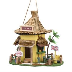 It will always be happy hour in your backyard when you hang this charming birdhouse in your favorite tree. A thatched roof tops this tropical getaway, complete with bar stools, drink special signs, an