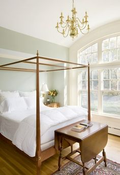 a minimalist approach to the four-poster bed