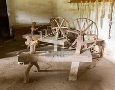 Old spinning wheel made from timber and branches in La Purisima mission California Stock Photo