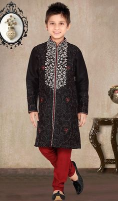 Black art silk and raw silk sherwani comprising resham embroidered foliage patterned collar and bodice. Self colored embroidered pretty patterns with sporadically sprinkled crystals embellishment adorns the look.  #NewBlackAndRedFloralDesignKurtaPajama