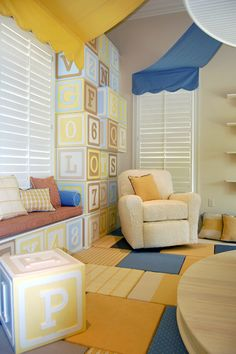 the built-in shelving and window seat are made of giant stacked letter blocks.  the blocks actually open up and hide storage.