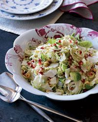 Brussels Sprout Slaw with Hazelnuts and Pomegranate Recipe on Food & Wine - paired this with BBQ Pulled Pork Sliders - simply amazing.