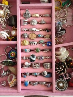 Came up with this idea about buying old (or new) costume jewelry when I was broke, just spending one dollar for a ring while looking around resale shops, and my collection grew and grew... one dollar at a time. Every time I shopped at a thrift store or garage sale or antique shop, I bought just one. They are kind of charming.