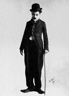 """ Charlie Chaplin posing in his Tramp costume """