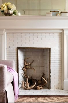 Faux Fireplace Love the inner brick backing...I would use either thin wood, and glue those brick pieces on and arrange in there or thick project board...in red brick smokey colors...and fit it right...
