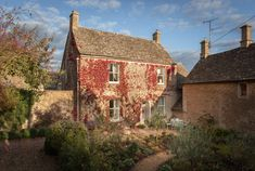 A luxury self-catering cottage in Bibury in the heart of the Cotswolds, The Flower Press is close to the iconic Arlington Row and is the perfect couples´ retreat Arlington Row, Unique Cottages, England Houses, Self Catering Cottages, Step Inside, Acre, The Row, Cabin, Luxury