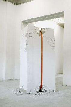 """' A project to shatter the rigidness of a material such as cement and make it seem mercurial and fragile. Erika Hock (born in 1981) is a young German artist who likes to break walls as she plays with their resistance. All that's needed in fact is a belt to damage the clean and rigid geometry of a hunk of wall. An approach that may well contest the """"infrastructural ideas"""" that currently permeate modern art. ' (via CoSTUME NATIONAL)"""