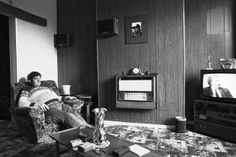 A miner watches an interview with NUM President Arthur Scargill in Wombwell, South Yorkshire, 1984.