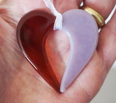 This is a beautiful small fused Glass Open Heart Pendant/Suncatcher in Lavender & Transparent Amber handmade by my Husband Mark John and being fired in a digitally controlled Kiln by 1400 Degrees. Colour: Lavender & Transparent Amber Size: approx 5cm x 4.5cm Thanks for looking Doris