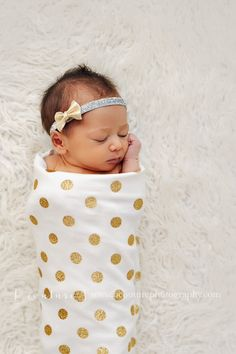 "This listing is for a gold glitter polka dot swaddling blanket. You can choose to purchase with a hat or knotted headband (headband is pictured in the last photo)! from the drop down menu. The material is a super soft organic cotton. The blanket size is 35""x35"", the edges are professionally serged and the corners are rounded. Makes for a gorgeous baby shower gift. Each blanket is detailed and very carefully made so please allow for up to 3 weeks for production.Beautifu..."