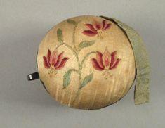 "Pennsylvania silkwork pinball with silver strap, inscribed ""Hannah Antram 1800""."