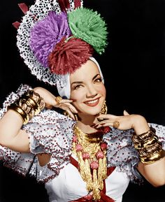 """Carmen Miranda, 1909-1955 Was a Portuguese Born Brazilian, samba singer, broardway & Hollywood actress & film star in the 40's, 50's. Was known as """"The Brazilian Bombshell"""" she was by far one of the highest earning actresses in America. Her signature Fruit hat and outfit she designed herself. She was a very talented dancer and actress."""
