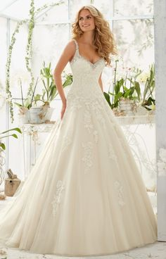 Mori Lee 2811 is a tulle ball gown with crystal beaded edging and alencon lace appliques.