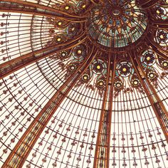 The stunning Art Nouveau domed ceiling of the Galeries Lafayette department store in Paris.