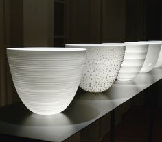 Bowls, porcelain, D 32 cm, H 32 cm. Arnold Annen: unglazed Limoges porcelain, he shaves the already ultra-thin walls of large bowls down to the thinness of a membrane with a knive. Or a gas torch to work on footless, parabola-shaped cast vessels, blasting off fragments and thus perforating their walls, as well as reducing their thickness to a millimeter.