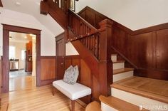 Craftsman Staircase with Wainscoting, Hardwood floors, High ceiling