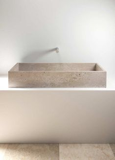 Love the raw and pure material of this minimal counter top wash basin by Vaselli. Could go in a kitchen or bathroom.