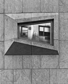 Marcel Breuer peers from the window of the former Whitney Museum in 1967