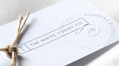 The White T-Shirt Co blind embossed tag by Precept.