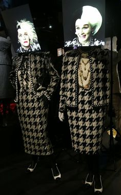"Two black and white costumes designed by Anthony Powell for the 2000 film ""102 Dalmatians"" lead female villain Cruella de Vil portrayed by actress Glenn Close on display at the Hollywood Costume exhibition at the Victoria and Albert museum in London, Tuesday, Oct. 16, 2012."