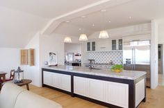 12 Bright and Elegant Kitchen Designs from Mal Corboy : Charming Eclectic Modern Kitchen Design with Classic Kitchen Cabinet and Wooden Floor