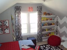 Toddler gets a big boy room full of DIY projects including a chevron wall, gutter bookshelves and art.
