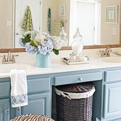 New paint and hardware was all the old vanity needed to give it new life. Ceramic tiles are secured to the large vanity mirror with building-materials adhesive to create an expensive look for less.