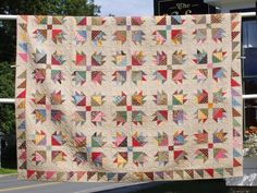 this is the nicest 'use it up' scrap quilt i've seen, using one of my favorite blocks, love the border too...