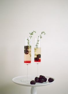 Add blackberry and thyme to your cocktail: http://www.stylemepretty.com/living/2015/11/09/prettiest-garnishes-to-take-cocktail-to-next-level/