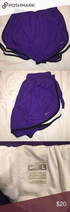 Nike dry tempo shorts Purple and white Nike shorts! My name is written on the inside tag (didn't post picture because don't want people knowing my last name) other than that they are in perfect condition, purple just isn't my color! Basically brand new Nike Shorts
