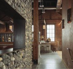 Havens South Designs loves using unexpected materials like a stone gabion wall in the interior of Tres Agaves restaurant by Zack/DeVito Gabion Stone, Wooden Greenhouses, Gabion Wall, Brick And Wood, Stone Cladding, Restaurant New York, Vintage Restaurant, Restaurant Interior Design, Commercial Interiors